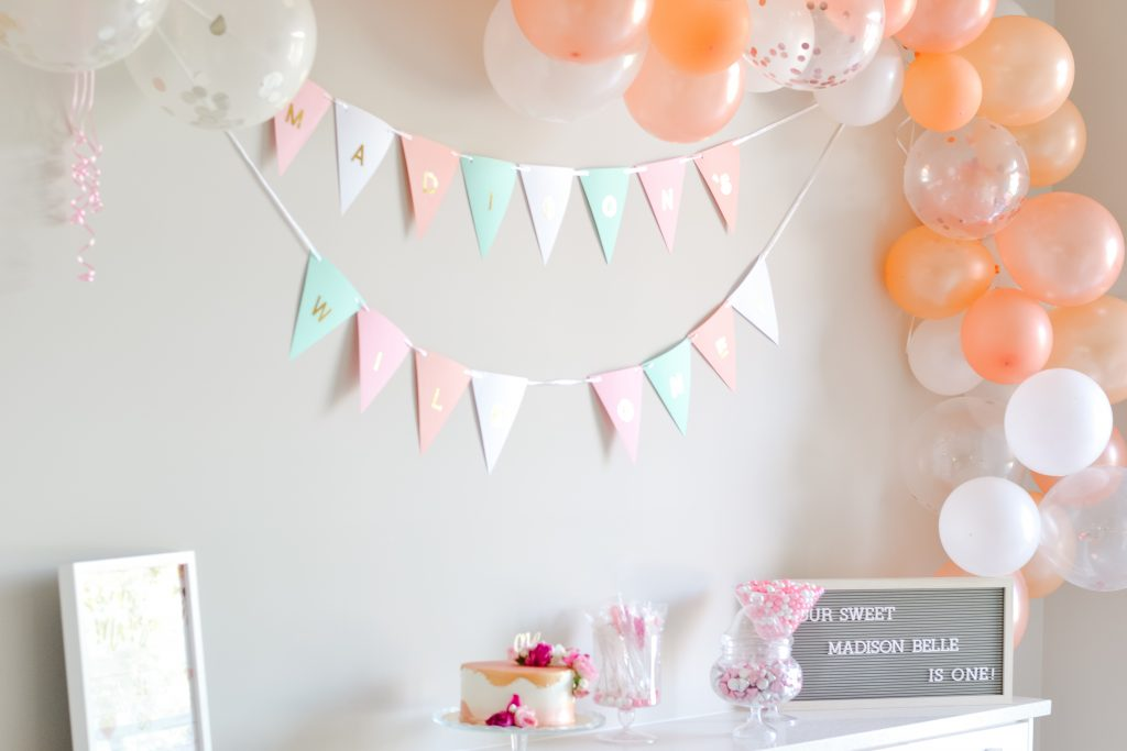 Simple modern setup. Balloon garland kit in our champagne pink and cream colors! Check out my 5 best tips for planning your baby's birthday party!