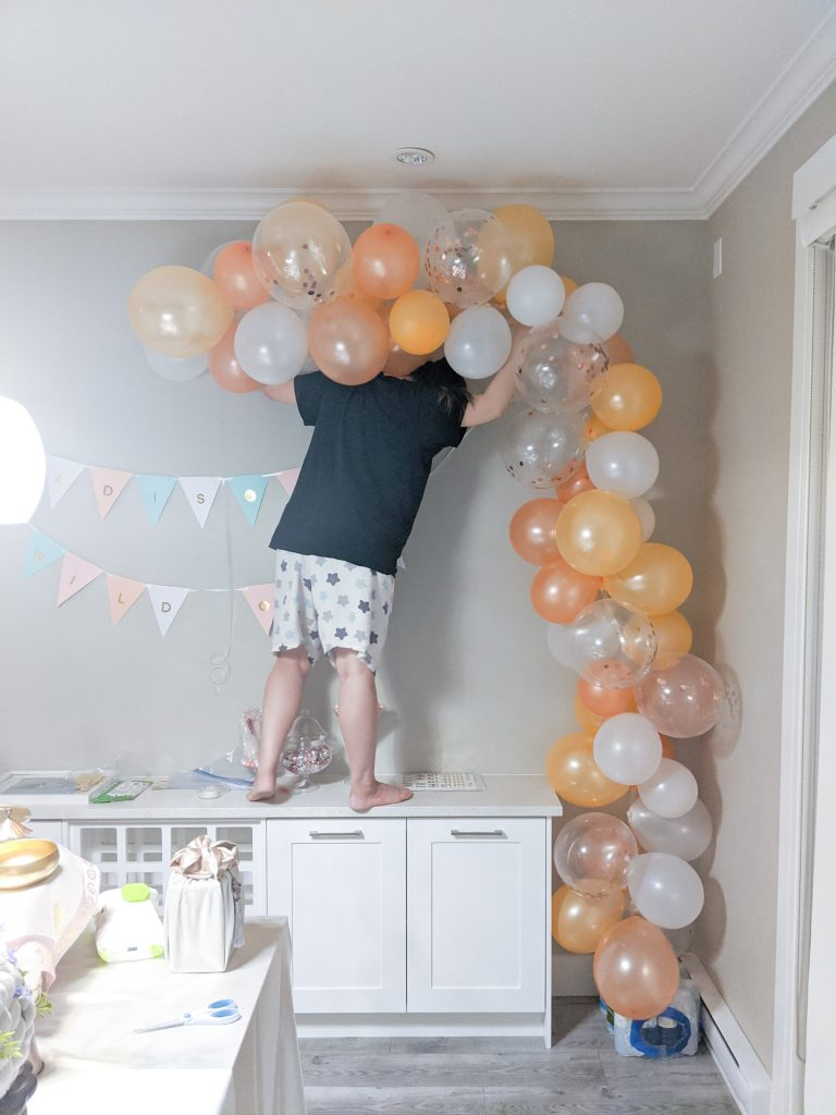 The night before setup of the balloon garland. The set up process for decorating a party is lengthy. Give yourself plenty of time. Check out my 5 best tips for planning your baby's birthday party!