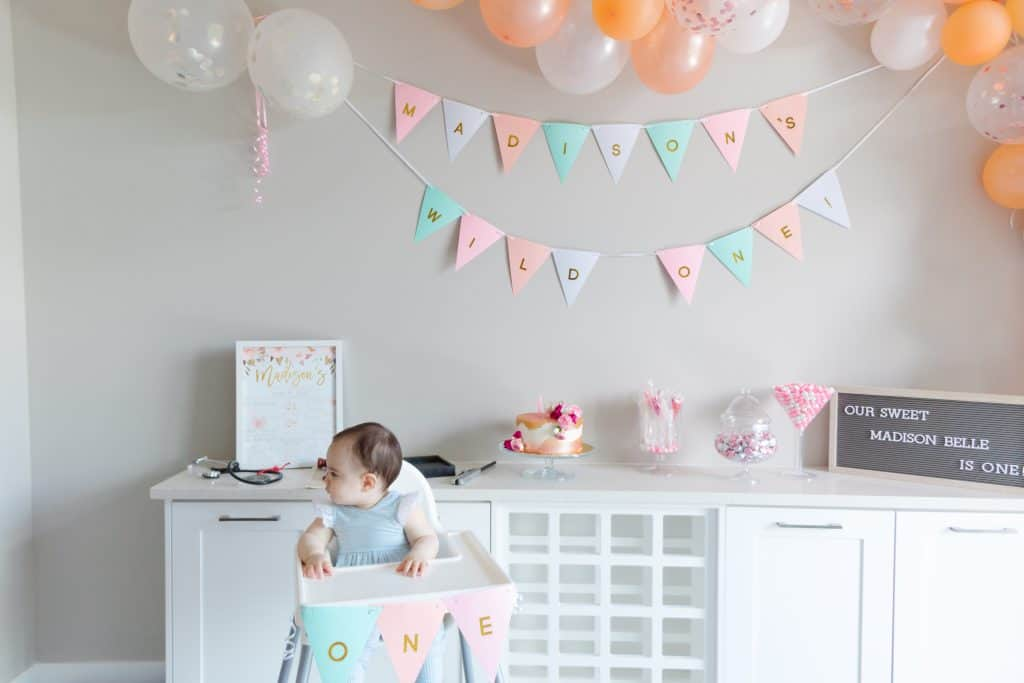 """The modern setup with our """"Wild One"""" theme of champagne pink and cream colors for your baby's first birthday party. Check out my 5 best tips for planning your baby's birthday party!"""